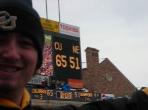 A happy camper celebrates the look of the scoreboard