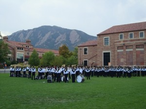 The CU band warms up with the Flatirons in the background